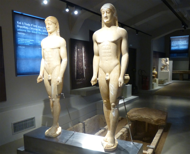 statues of kouroi inside corinth's museum